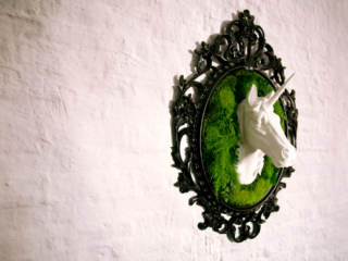Artisan Moss White Faux Taxidermy Unicorn plant frame.