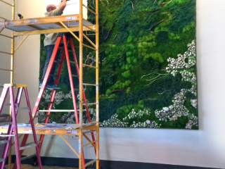 Artisan Moss plant painting installation in Austin luxury loft.