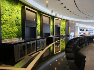 Artisan Moss green wall behind the bar at Hilton Cleveland Downtown